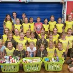 Girls from St Leonard's Brownies with their baskets of collected food.